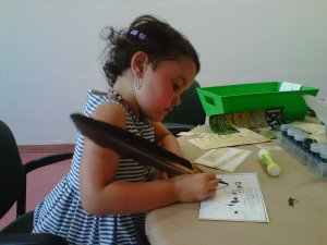 learning how to use a quill at the CBU Art Gallery's Hands On Center